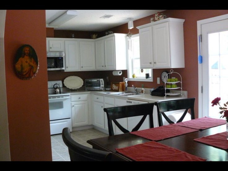 Burnt orange and white kitchen, just prior to replacing the appliances