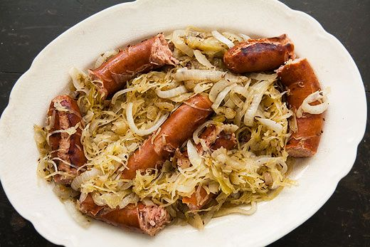 Grilled polish sausage with sauerkraut and onions, simmered in beer ...