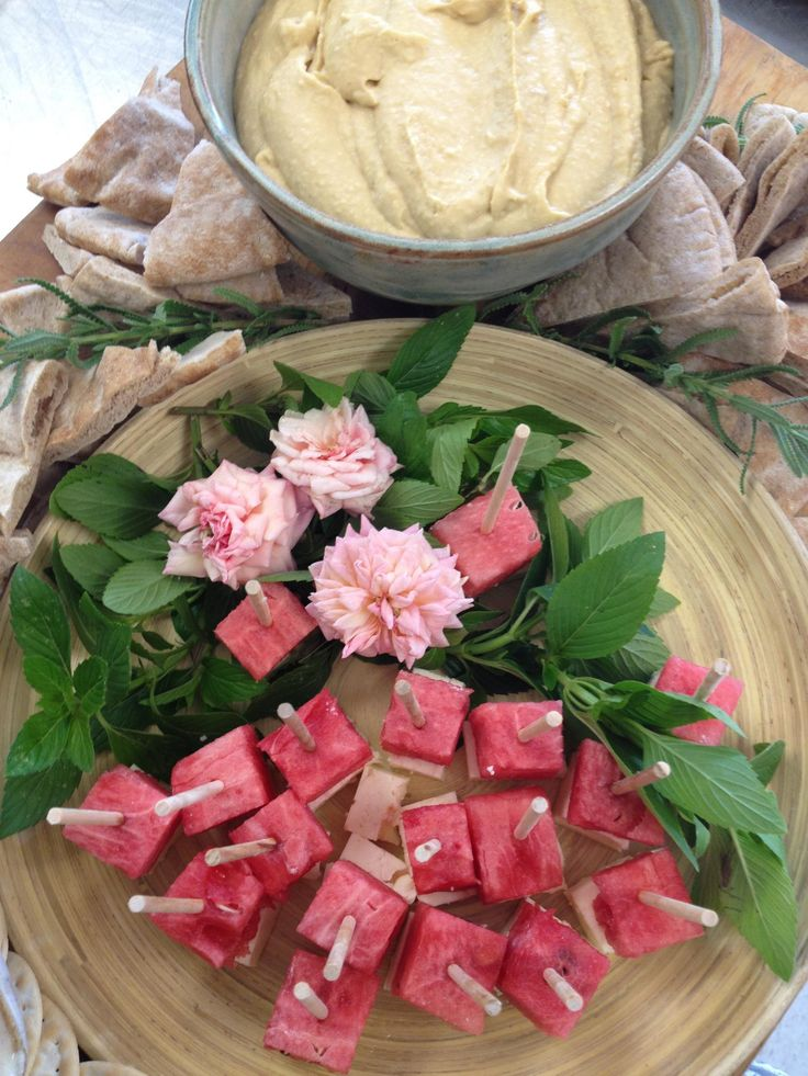 Watermelon and feta skewers with hummus and flatbreads.