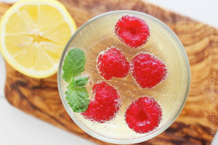 Limoncello And Prosecco Cooler With Raspberry Ice Cubes Recipes ...