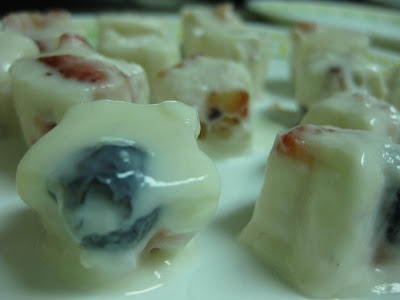 Mini Greek yogurt, berry, and honey popsicles