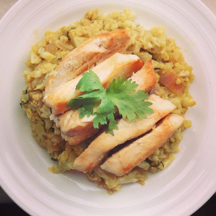 "... curry cauliflower ""rice"" with olive oil chicken. #whole30 #paleo"