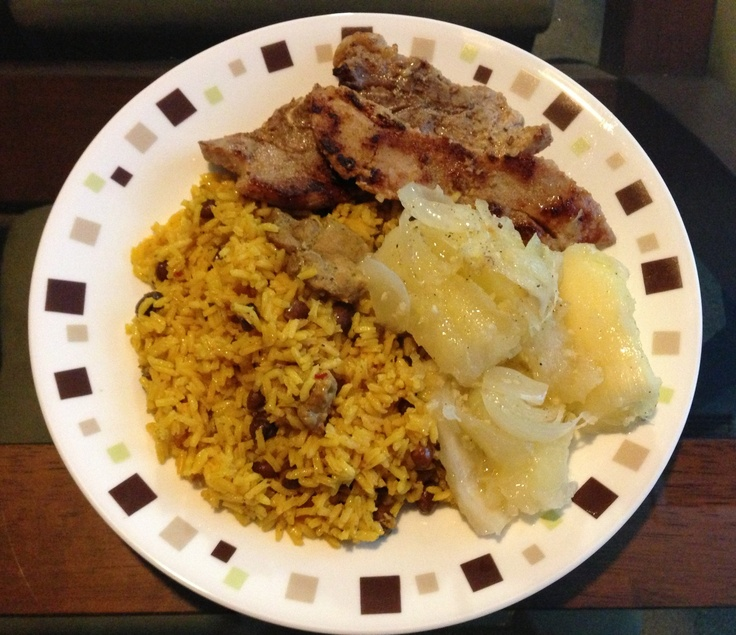 Arroz con gandules, chuletas y yuca. Rice with pigeon peas, pork chops ...