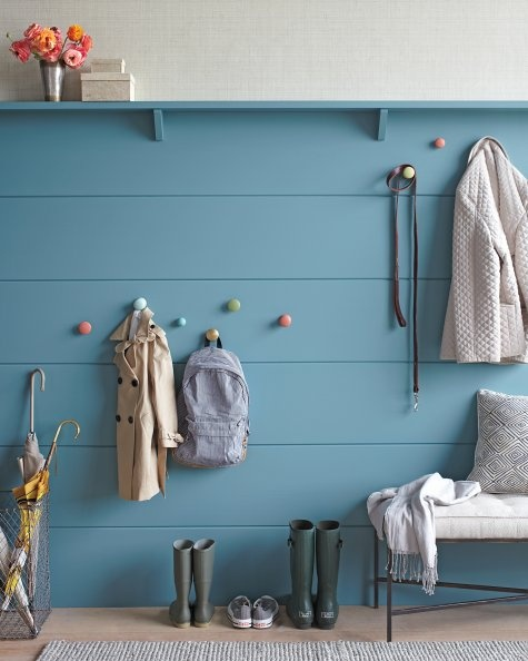 Mount knobs at kid-friendly heights to eliminate entryway clutter.