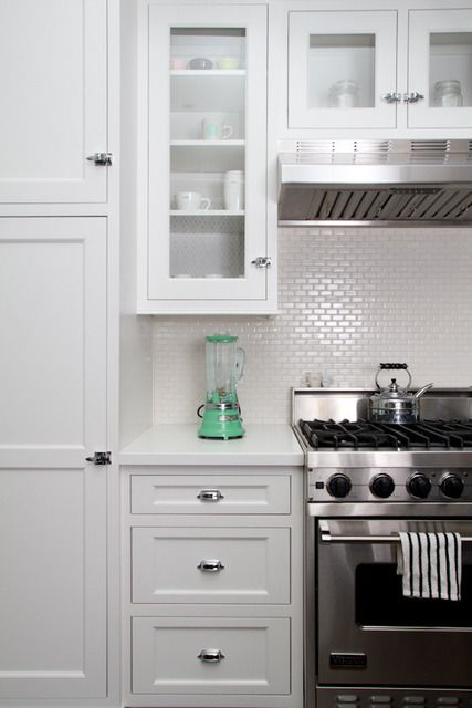 That tiny white subway tiles in this white kitchen sings to me.