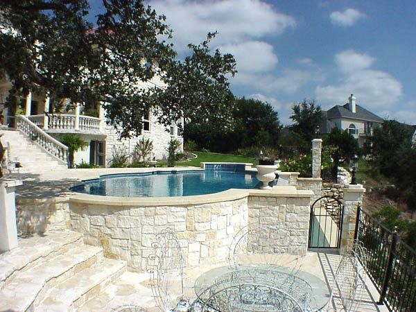 Pool on hillside stone surround patios and pools for Hillside pool ideas