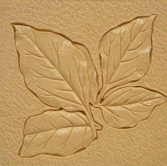 very nice relief carving. Simply lovely. Less is more...