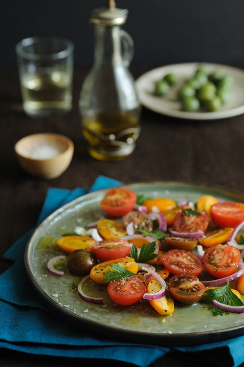 Heirloom tomato salad #saveur with onions and a tangy vinegarette ...