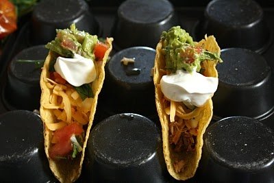 use a muffin tin to stand up your tacos