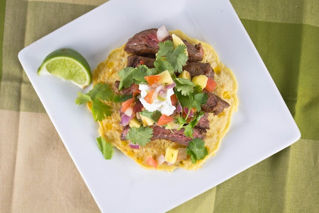 Skirt steak with corn cakes topped with cilantro, pico de gallo and ...