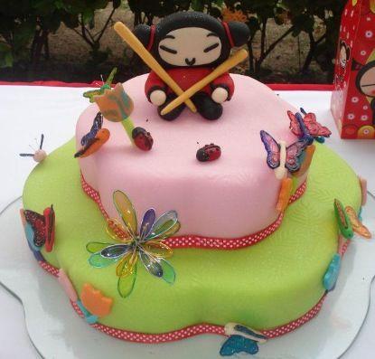 Torta infantil motivo pucca y mariposas modeladas