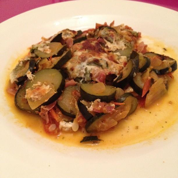 Courgettes gratin with onions, tomatoes, origano, ham, yogurt fat free ...