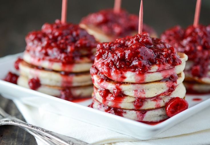 pancakes are served mini-style and drenched in a warm and sweet fresh ...