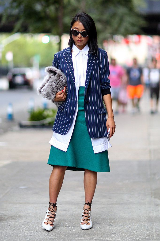 Margaret Zhang hints at Fall with pinstripes and a fur clutch in tow at NYFW.