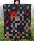 love this quilt. i want to make a very similar one. the darks against the red are so striking.  made by folk fibers