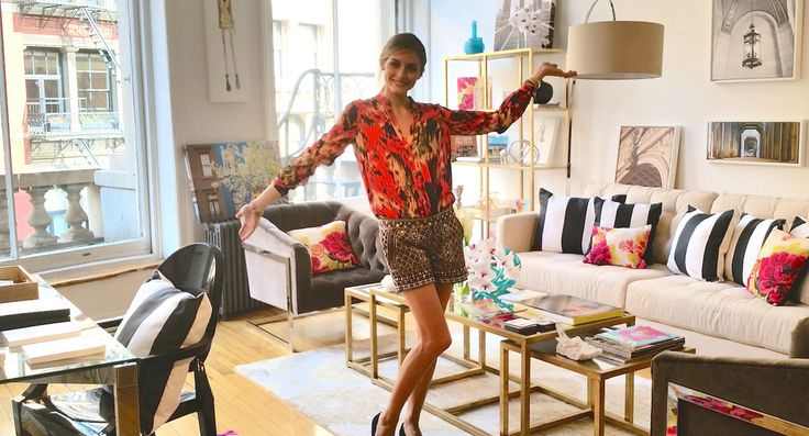 Olivia Palermo's Newest Role: Interior Decorator// striped pillow, floral pillows, tufted chairs, brass coffee table