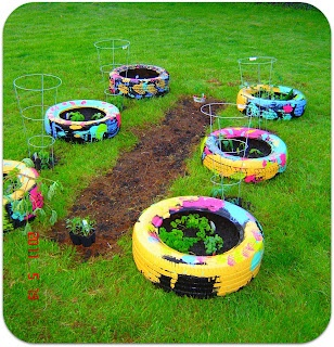 Tire garden the kids painted the tires for the home - Painted tires for gardens ...