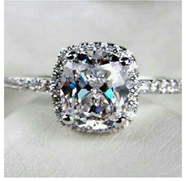 halo engagement ring cushion cut and platinum with a thin