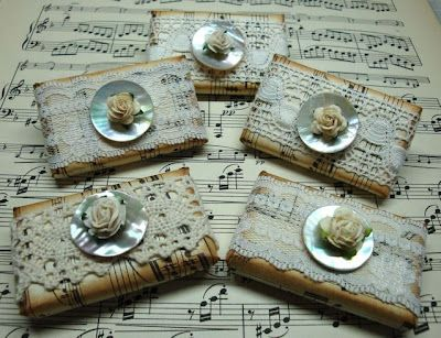 Guest soap wrapped in music paper and lace. Pearl buttons and roses on