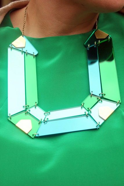 """My Gem Cut Statement Necklace is from our upcoming Autumn Winter 2013 collection. The emerald mirror perspex works really well with my dress. I can't wait for this collection to launch!"""" said Rosie (Tatty Devine designer) june 2013"