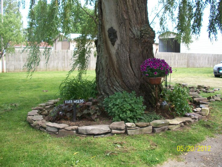 Small rock wall around tree garden backyard pinterest for Landscaping rocks under trees
