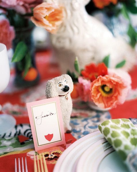 Staffordshire-dog figurines and vases of flowers decorating a table