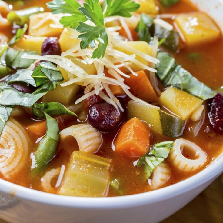 minestrone vegetable soup. Served topped with parmesan and fresh basil ...