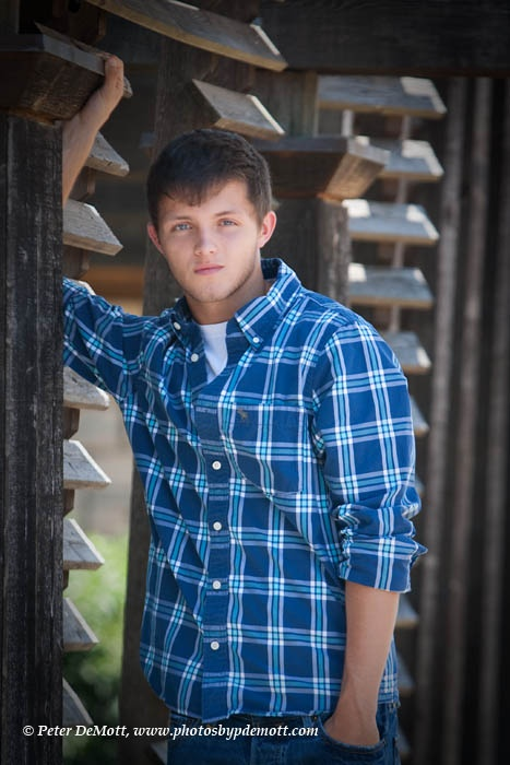 Senior portraits for boys need a strong feel. Hard shaped background also ads to feel in the Dayton, Ohio senior portrait by Peter DeMott Photography. http://www.photosbypdemott.com