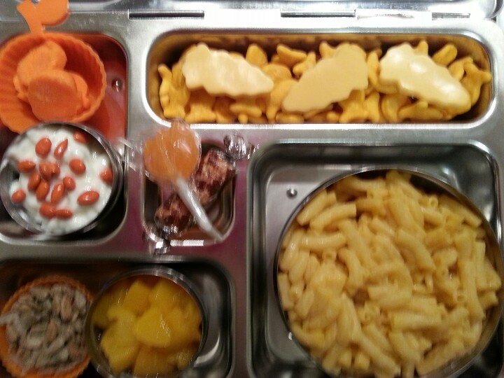 Macaroni and cheese, carrot pumpkins, coconut yogurt with orange candy ...