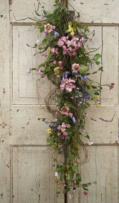 Door swag storage pinterest Spring flower arrangements for front door