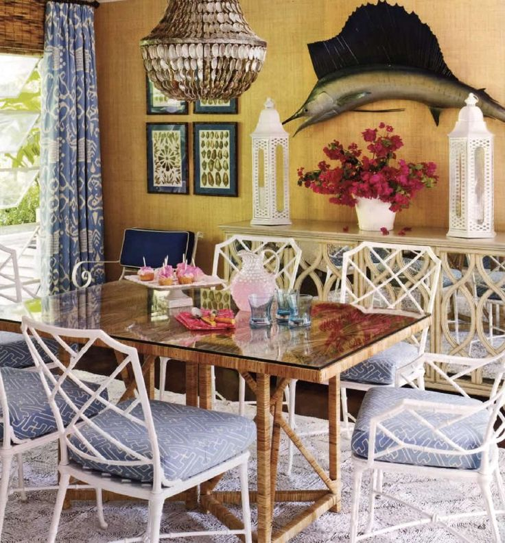 Meg Braff-fun dining chairs, table & alan campbell/china seas fabrics.  capiz shell chandelier.
