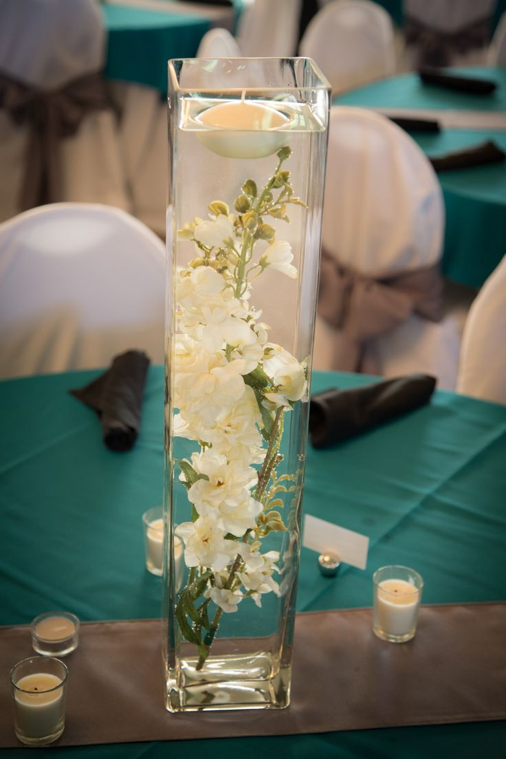 Tall glass vase flowers in water wedding centerpieces tea for Tall candle centerpieces