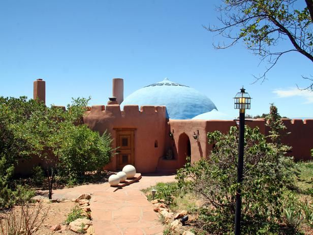#HouseHunters Faves:  Nestled on 10 acres in the foothills of the Sangre de Cristo Mountains, this Santa Fe, N.M., home is constructed entirely of adobe with traditional New Mexican elements, such as a wood-burning fireplace and hand-painted tiles. The unique blue dome also features a skylight and can be used as a space for meditation.