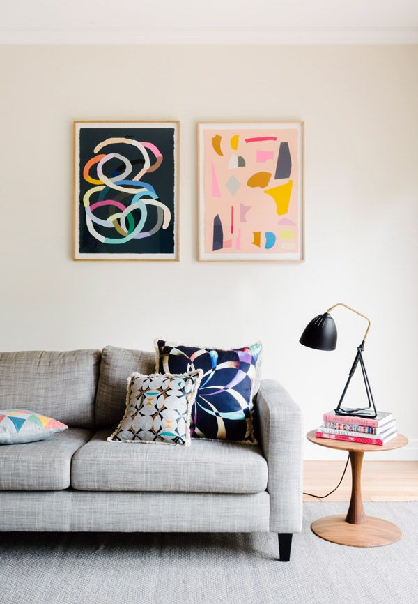 Living room details. Sofa by Jardan, rug by Armadillo & Co., lamp and side table from Grate Dane Furniture, cushions by Megan Park, and artw...