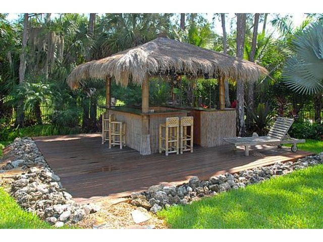 Backyard Tiki Bar Plans : Tiki Bar in the backyard! like the rocks surrounding the bar area