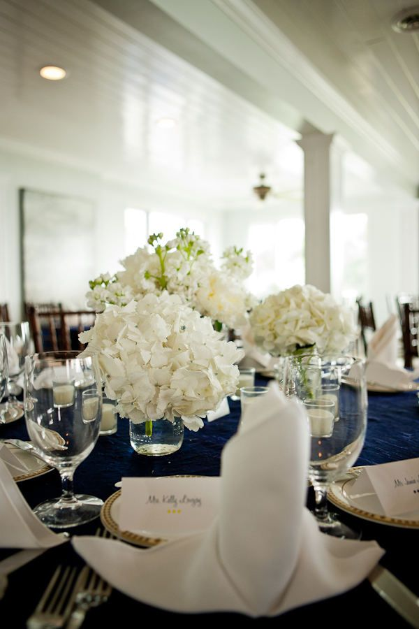 Large white blooms in a short vase against navy-colored runner. Crisp and elegant without being too stuffy. LOVE.