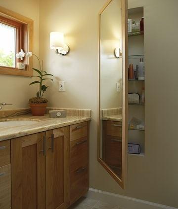 Mirror hides a cupboard - nice idea