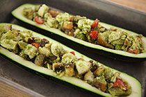 Pesto-Stuffed Zucchini... not sure what I think about this but I love ...