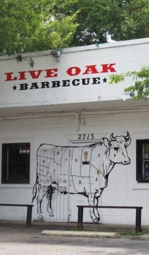 The facade of the live oak barbecue restaurant in austin tx features a