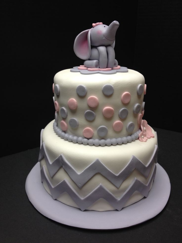 pink and gray baby shower cake with chevrons dots and fondant baby