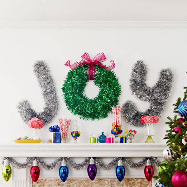 Tinsel wall decoration spelling JOY - I would love to do this in Wood and add LED lights. Could also do MERRY, BELIEVE...