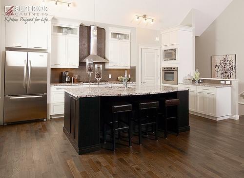 Light cabinets, dark wood floors, dark cabinet island