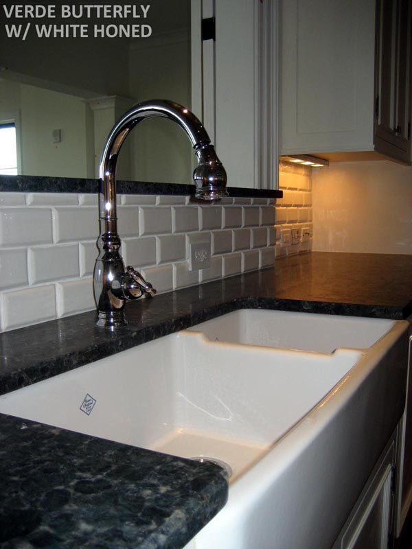 backsplash is a ceramic tile it is a 2x4 white porcelain tile with