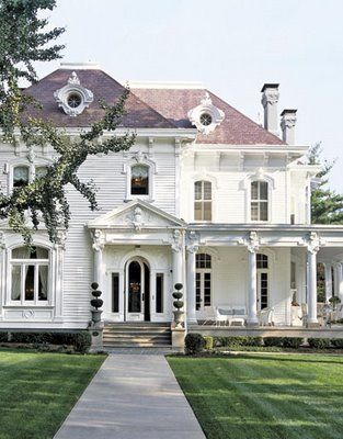 Beautiful white house...check out that porch! | Friday Favorites on www.andersonandgrant.com