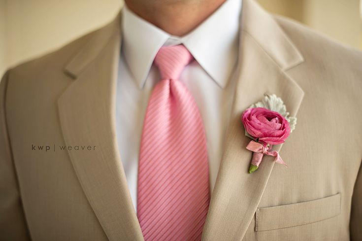 Pink Wedding suit tie. JULIE - This is the color of suit, tie and flowers for groomsmen that I think would look best. And the groom would have a different tie and lighter color pink or probably white flower