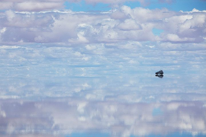 """""""In the rainy season the Salar de Uyuni [salt lake in Bolivia] is transformed into a giant mirror: a couple of inches of water cover it, reflecting the sky as far as you can see..."""""""