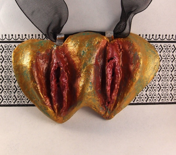 Any bland outfit can be snazzed up with a metallic conjoined vulva pendant.