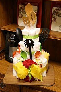 Dish towel cake with kitchen utensils