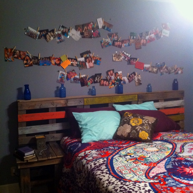 Headboard out of crates. Pictures clipped on twine. Adorable.