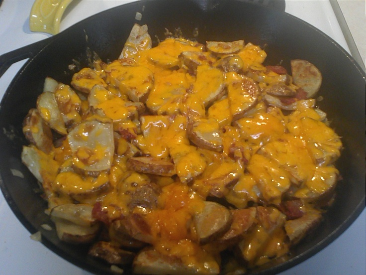 ... baked potatoes mixed with bacon and onion...covered with cheese